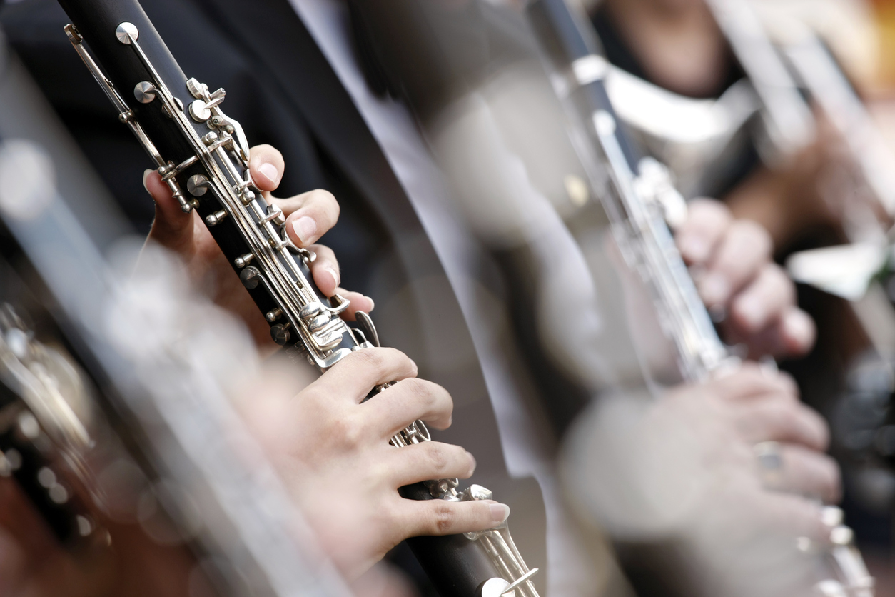 Close-up of clarinet played in orchestra with shallow DOF